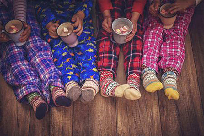 kids in pajamas drinking hot chocolate