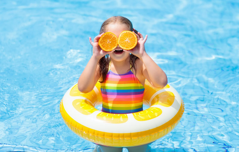 child in swimming inflatable tube in pool